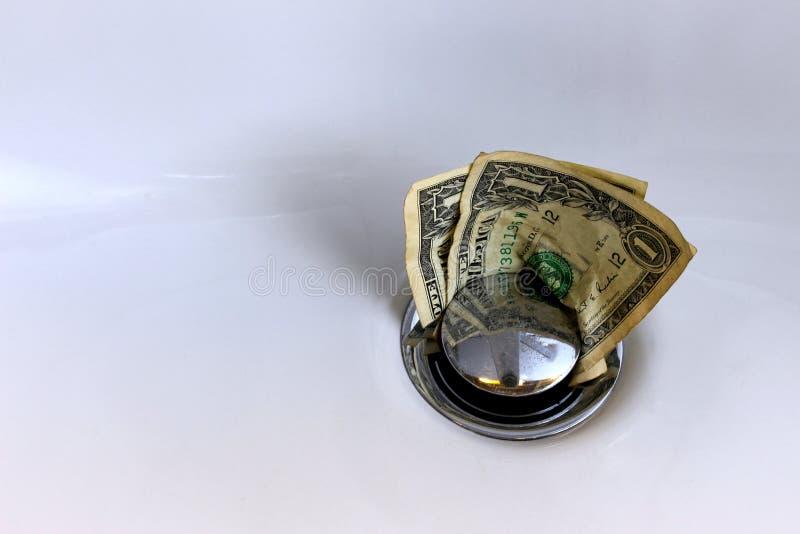 Pieniądze idą w dół fotografia stock