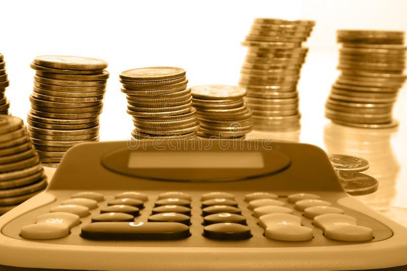pieniądze mennicze stacks kalkulator zdjęcie stock