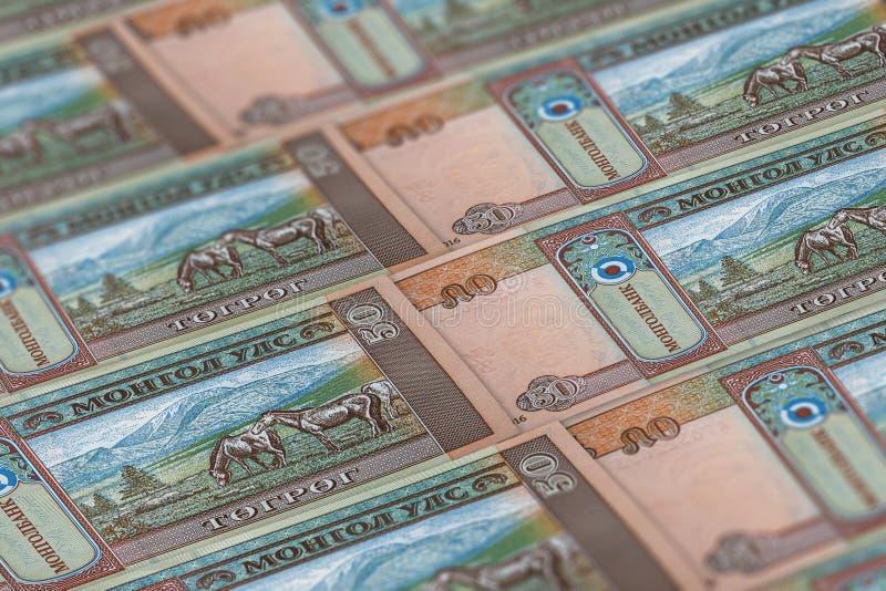 Pieniądze Mongolii tło finansowe 50 tugrionów zdjęcia royalty free