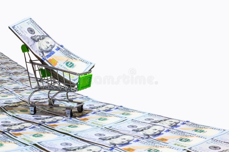 Pieniądze nowego projekta dolarowy wózek na zakupy na sto USA dolarów banknotów drogach odizolowywać na białym tle z ścinek ścież fotografia royalty free