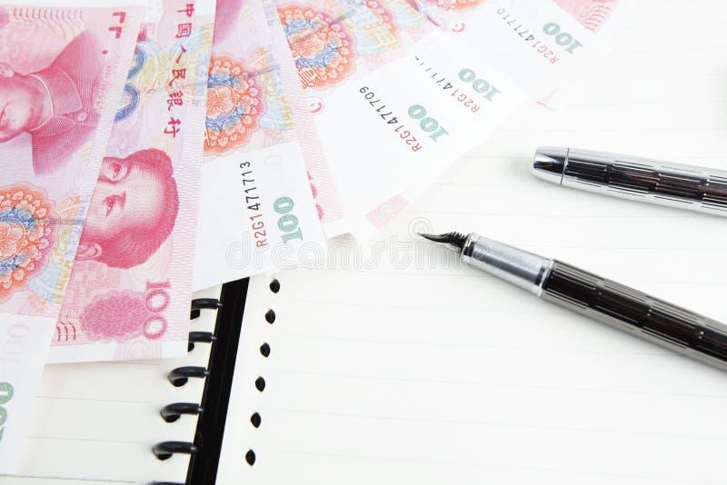pieniądze pióro obraz stock