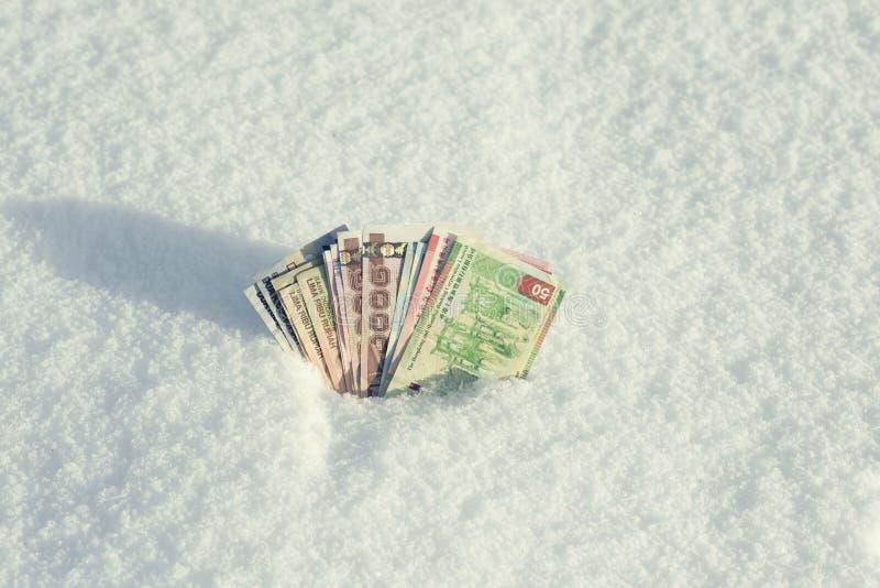 Pieniądze południowo-wschodni Azja w śniegu w zimie Waluta Hong Kong, Indonezja, Malezja, Chiny, Tajlandzki zdjęcia royalty free