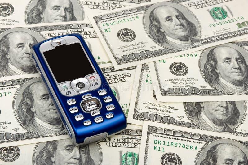 pieniądze tła ruchomy telefon zdjęcia stock