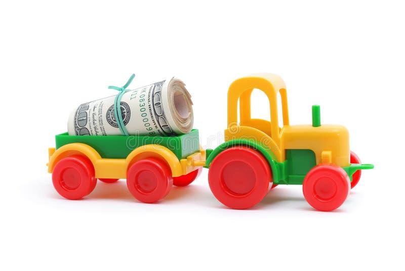 pieniądze transortation zabawkarski ciągnikowy fotografia stock