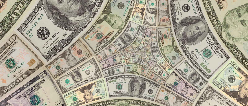 Pieniądze USA dolarów trójboka spirala sto, pięćdziesiąt, dziesięć dolarów banknotów USA dolarów tła abstrakcjonistyczny wzór Pie zdjęcia royalty free