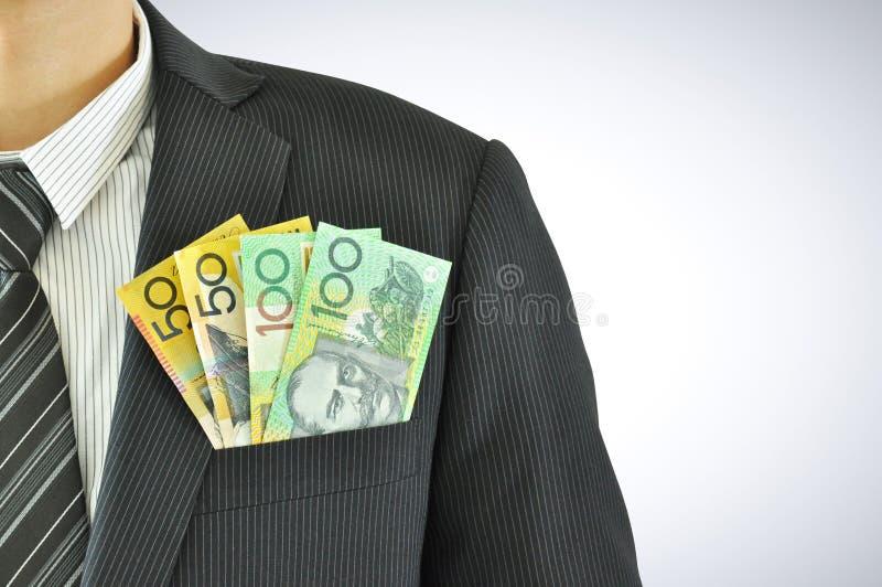 Pieniądze w biznesmen kieszeni kostiumu, dolary australijscy rachunków (AUD) zdjęcia royalty free