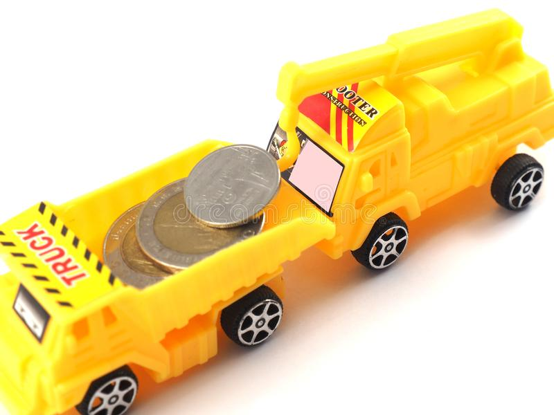 Pieniądze zabawki ciężarówki moneta zdjęcia royalty free