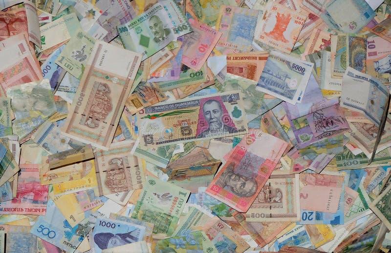 Pieniądze zaludnia świat zdjęcia royalty free
