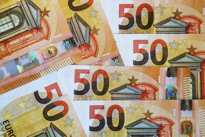 Pieniężny tło z 50 euro rachunkami zdjęcia royalty free