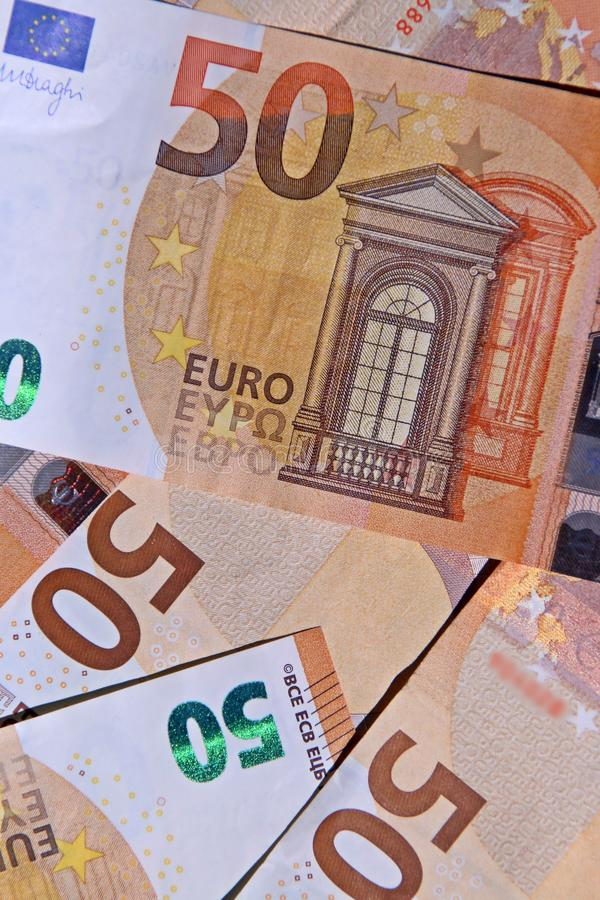 Pieniężny tło z 50 euro rachunkami obrazy royalty free