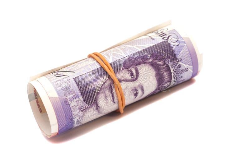 Pieniędzy brytyjskich funtów szterlinga gbp pod gumowym zespołem zdjęcia stock