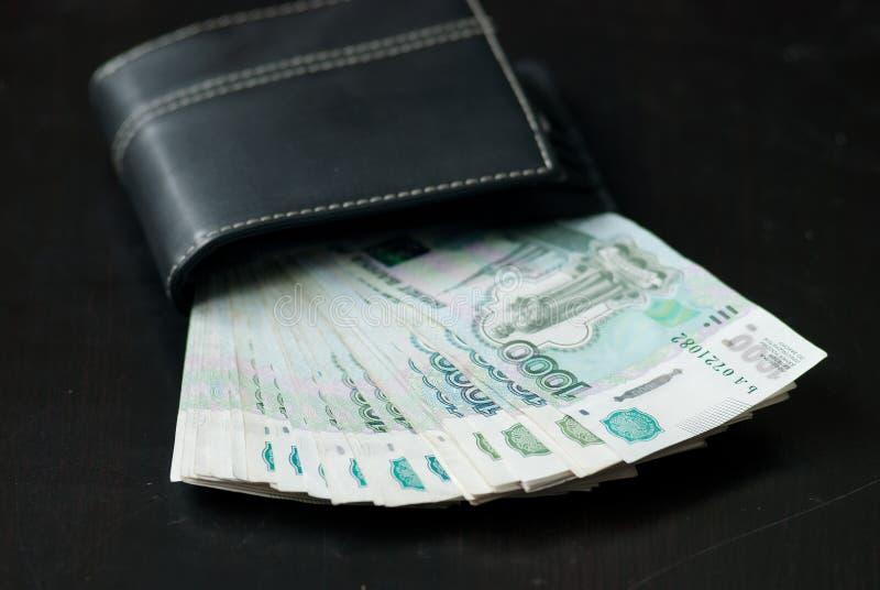 Download Pieniądze w portflu obraz stock. Obraz złożonej z billfold - 57656353