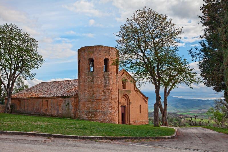 Pienza, Сиена, Тоскана, Италия: средневековый двенадцатый век Pieve di Corsignano церков стоковая фотография