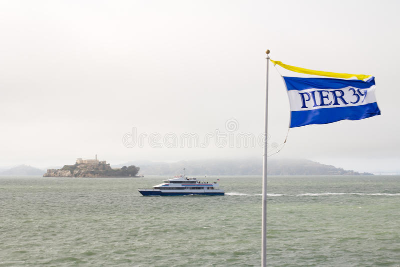 Pier 39 flag and alcatraz stock photography