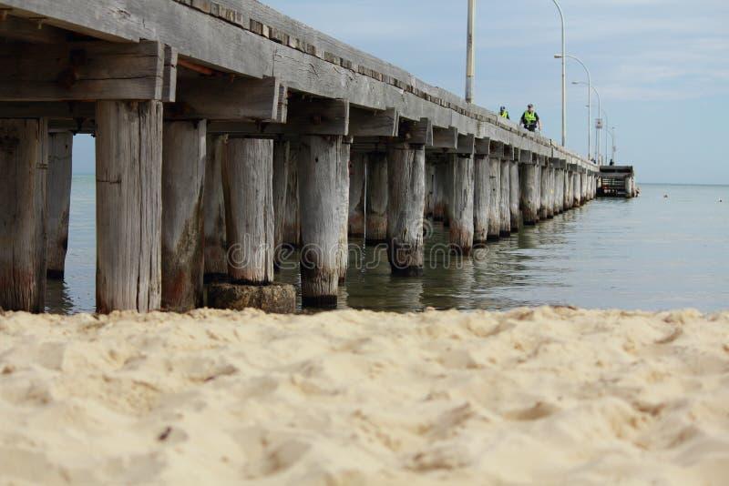 Pier. A pier on the beach stock photos