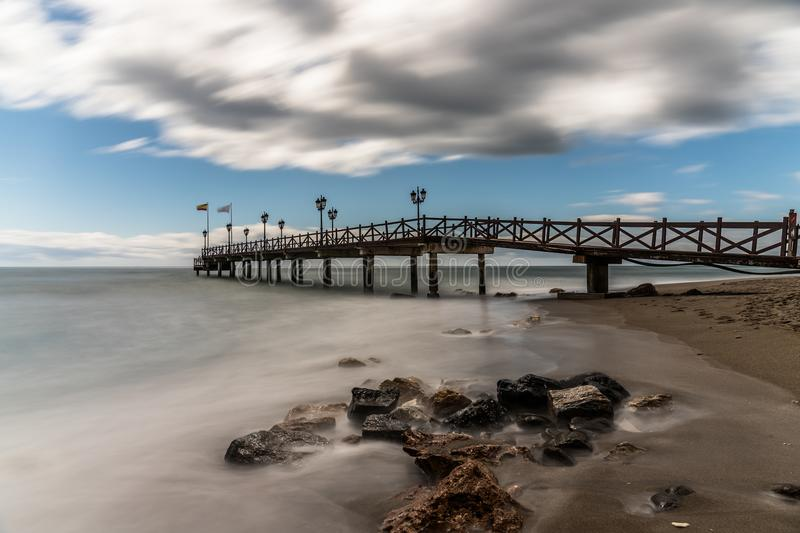 Pier on a beach in Marbella, Spain. stock image