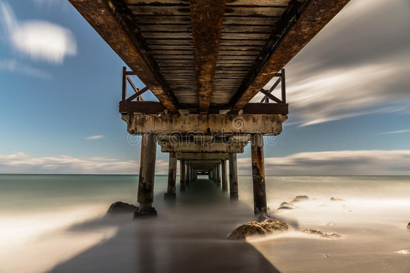 Pier on a beach in Marbella, Spain. royalty free stock photography
