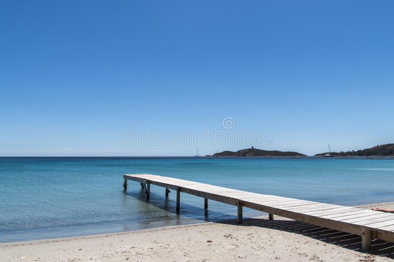 Pier on the beach royalty free stock photography
