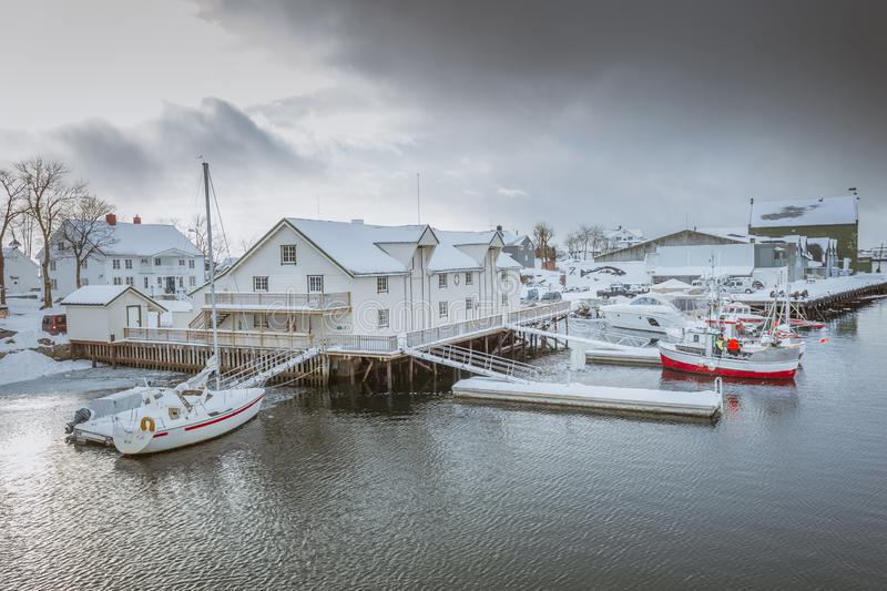 Pier with a beautiful house on the shore of the sea bay royalty free stock photography