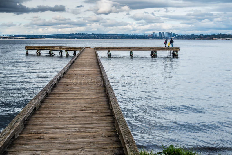 Pier And Bellevue. A view of a pier on Lake Washington in Seattle. Bellevue can be seen in the disttance royalty free stock photo