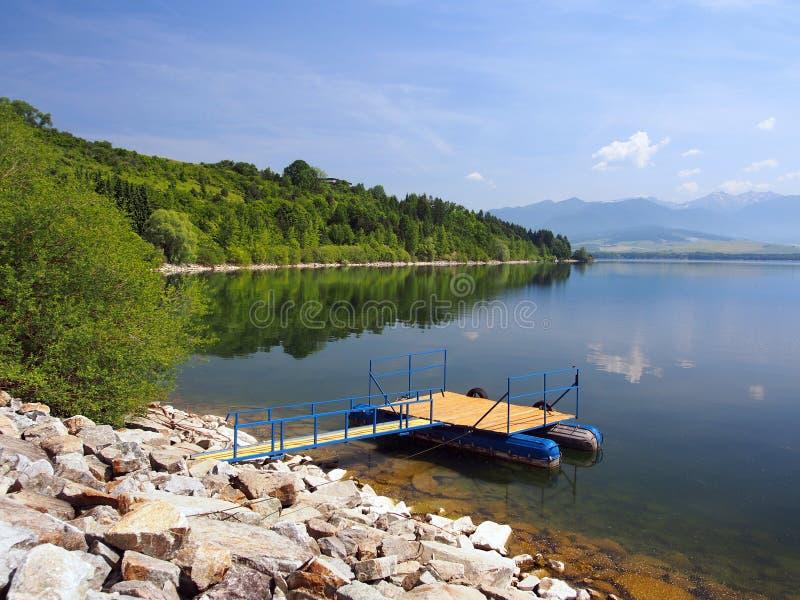 The pier for boats at Liptovska Mara, Slovakia stock photo