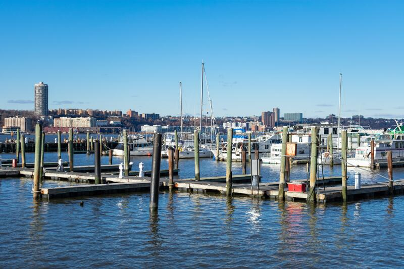 Pier with Boats at the 79th Street Boat Basin on the Upper West Side of New York City along the Hudson River. Pier with docked boats at the 79th Street Boat stock photos