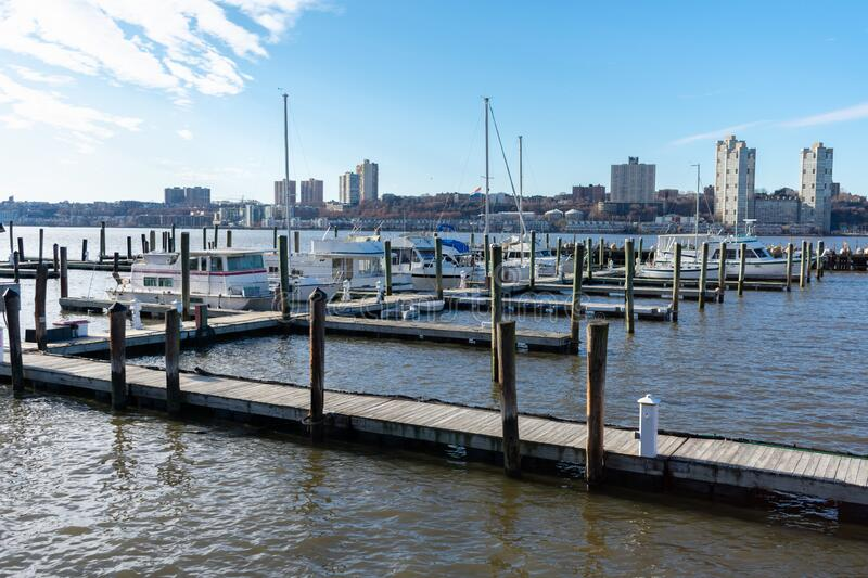 Pier with Boats at the 79th Street Boat Basin on the Upper West Side of New York City along the Hudson River. Pier with docked boats at the 79th Street Boat stock photography