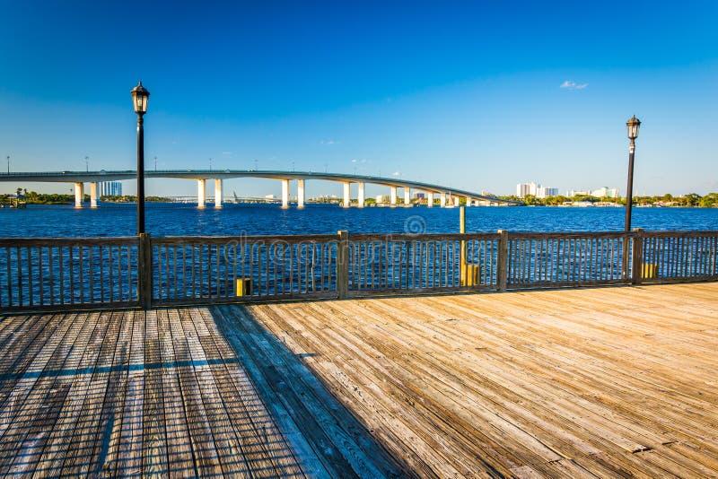 Pier and bridge over the Halifax River in Daytona Beach, Florida royalty free stock photo