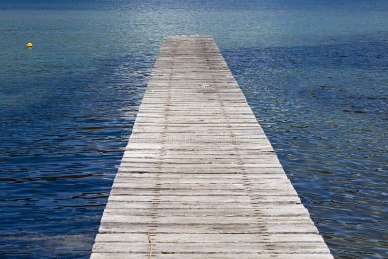 Pier into the calm sea. Pier into the calm blue sea stock photography