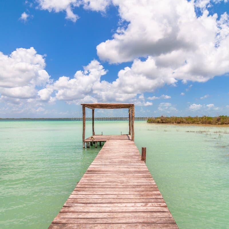 Pier in Caribbean Bacalar lagoon, Quintana Roo, Mexico. Peaceful pier in the Mayan lagoon area called Bacalar, Quintana Roo, Mexico stock photography