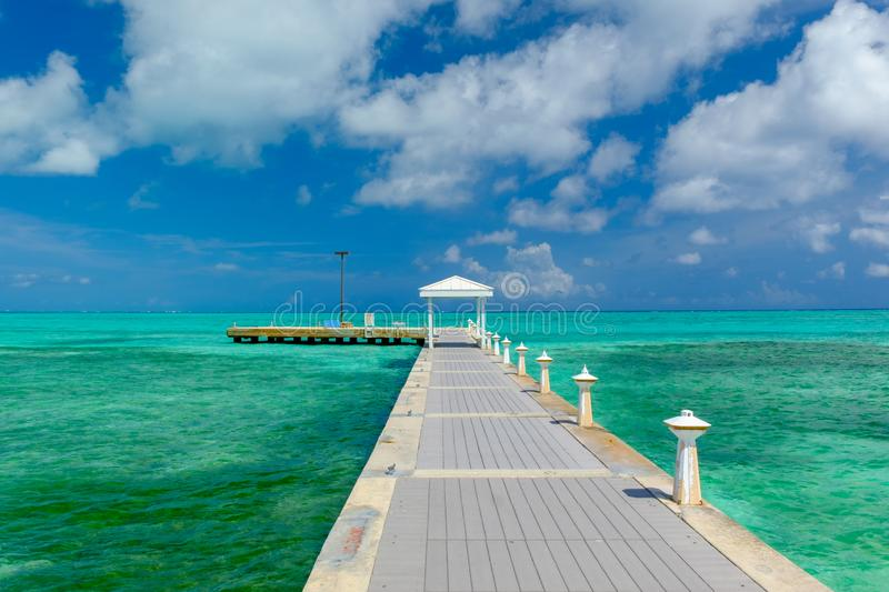 Grand Cayman-Rum Point Pier. Pier on the Caribbean sea at Rum Point, Grand Cayman, Cayman Islands stock photo