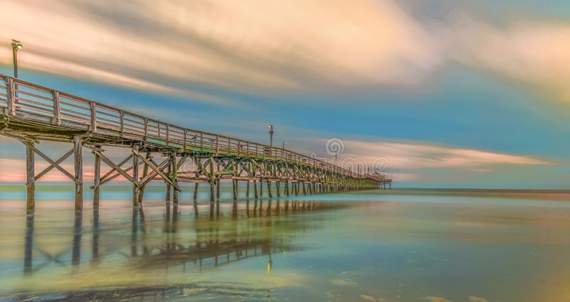 Pier at Cherry Grove Beach. The pier at Cherry Grove Beach South Carolina with blur sky and clouds royalty free stock image