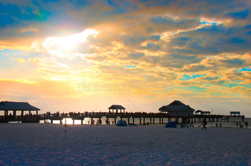 Pier 60 Clearwater Beach Florida sunset. Colorful sunset at Clearwater Beach, Florida, with Pier 60 and a sandy beach in the foreground royalty free stock photography