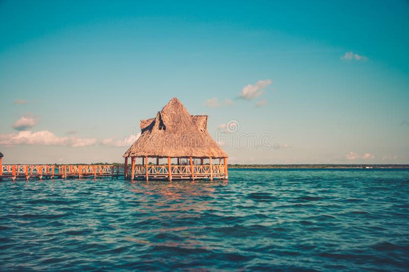 Pier with clouds and blue water at the Laguna Bacalar, Chetumal, Quintana Roo, Mexico. royalty free stock images