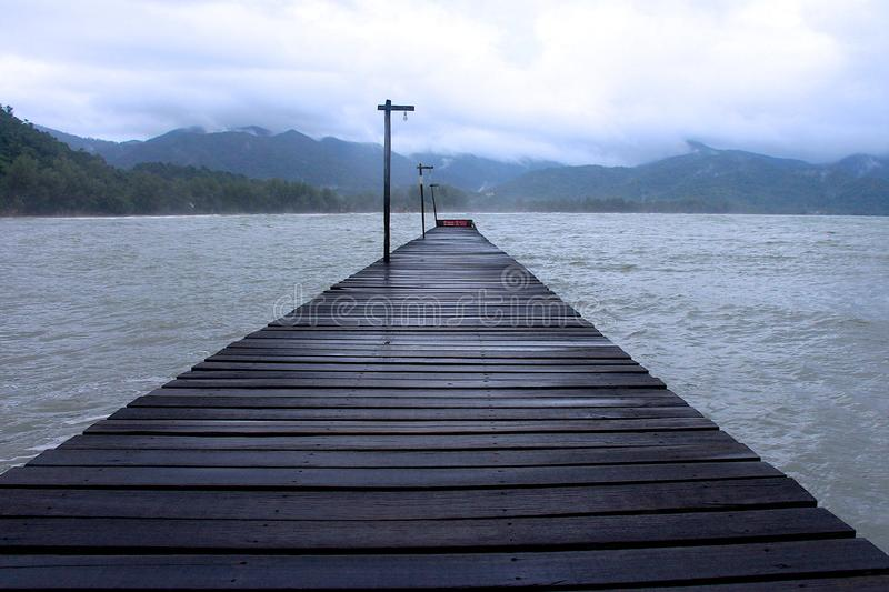 Pier and cloudy weather. In Thailand royalty free stock photography