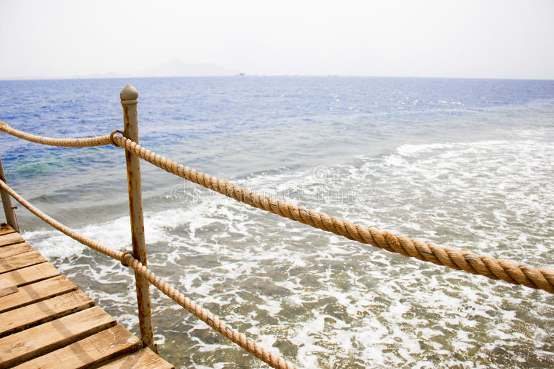 Download Pier On The Coast Royalty Free Stock Photos - Image: 27069038