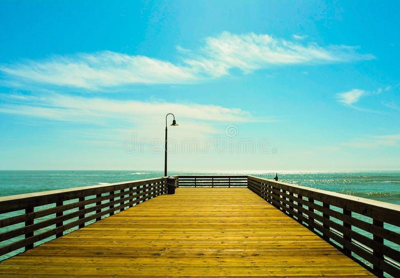 Pier in daylight stock images