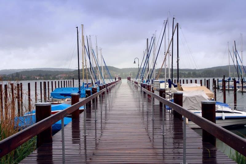 Pier des Schweizer Sees lizenzfreies stockbild