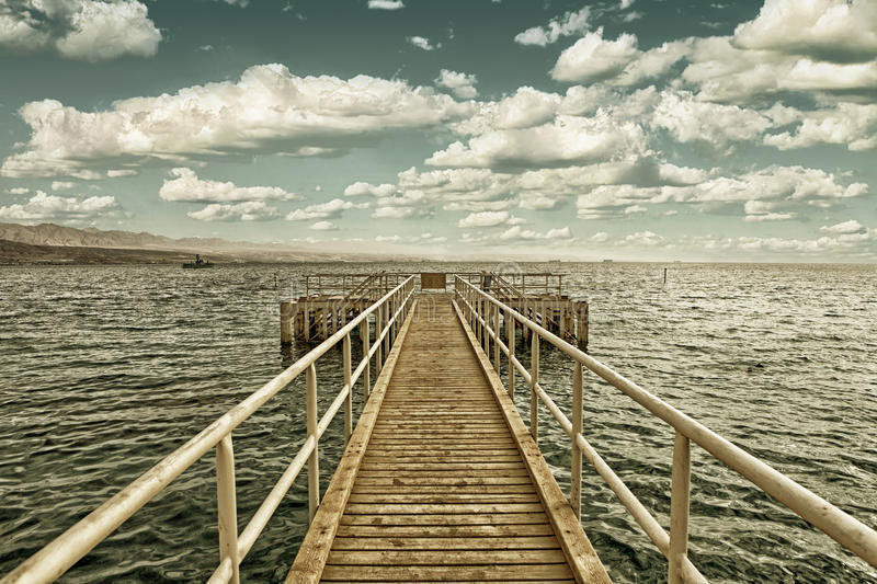 Pier for divers on beach of Red sea in Eilat stock image