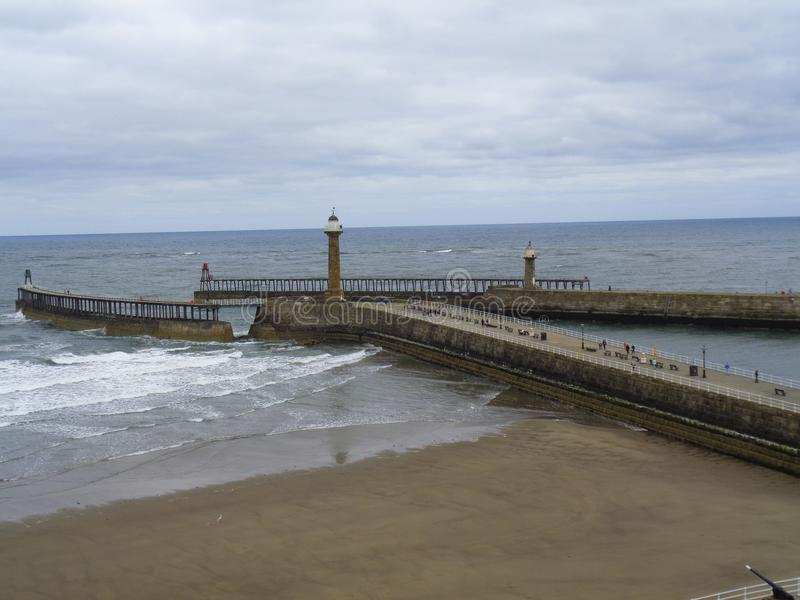 a pier in England by stormy weather stock photo