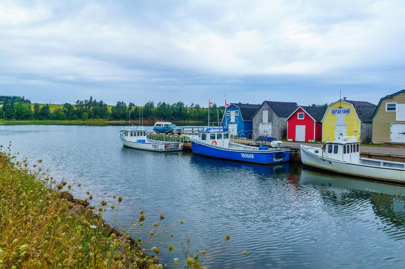 Pier, fishing boats and colorful houses, PEI stock photos