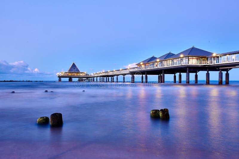 pier of Heringsdorf at night royalty free stock image