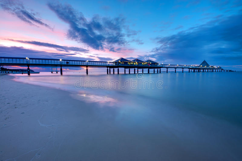 The pier of Heringsdorf at sunset stock images
