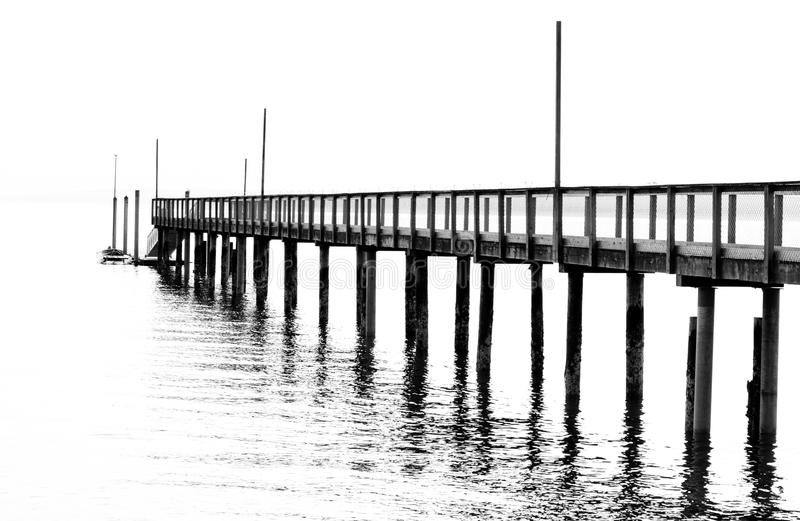 Pier. High key photo of a pier or dock over the water royalty free stock photos
