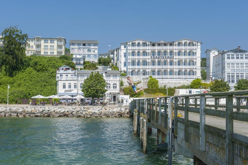 Pier with historic villas and hotel Fürstenhof in Sassnitz on t. Pier with historic villas and hotel Fürstenhof, Sassnitz, Rügen, Mecklenburg-Vorpommern royalty free stock photos