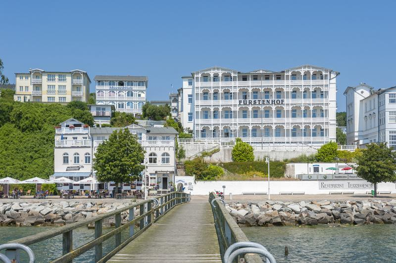 Pier with historic villas and hotel Fürstenhof in Sassnitz on t. Pier with historic villas and hotel Fürstenhof, Sassnitz, Rügen, Mecklenburg-Vorpommern royalty free stock image