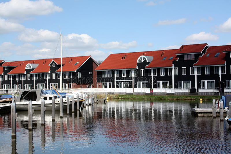 Pier houses and boats royalty free stock photo