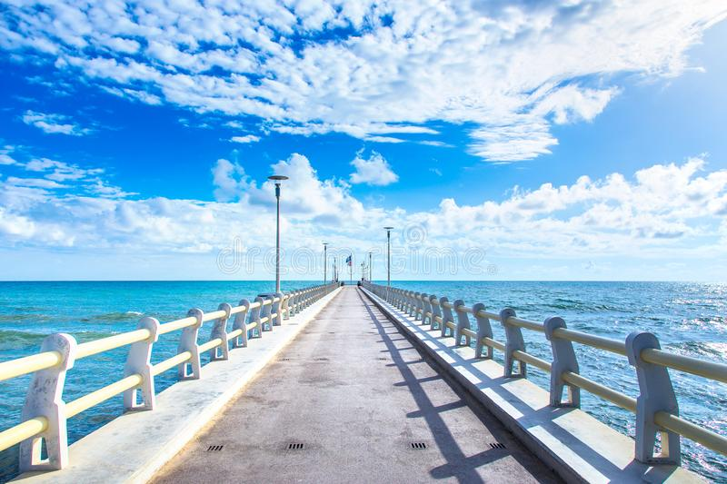 Pier or jetty and sea in Forte dei Marmi Versilia Tuscany Italy. Pier or jetty, footpath promenade and sea in Forte dei Marmi Versilia Tuscany Italy royalty free stock photography