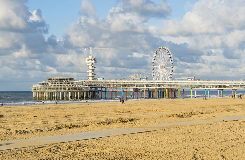 The pier jetty of Scheveningen beach a very popular and touristic hot spot of the Netherlands. The well-known pier jetty of Scheveningen beach a very popular and stock image