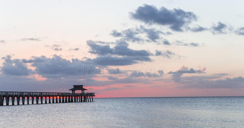 Pier jetty at sunset in Naples, forida, usa. A view in NAPLES, UNITED STATES, NOVEMBER 30, 2017 : pier jetty at sunset , november 30 2017, in Naples, Florida royalty free stock images